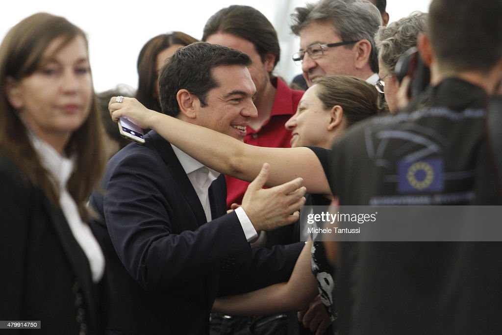 Greek Prime Minister Alexis Tsipras is greeted on his arrival in the plenary hall at the European Parliament on July 8, 2015 in Strasbourg, France. Eurozone member nations have given Greece until Thursday to come up with new proposals to bring the country out of its debt crisis and qualify for further assistance from international creditors. Analysts say that should this final effort fail a departure of Greece from the Eurozone will be inevitable.