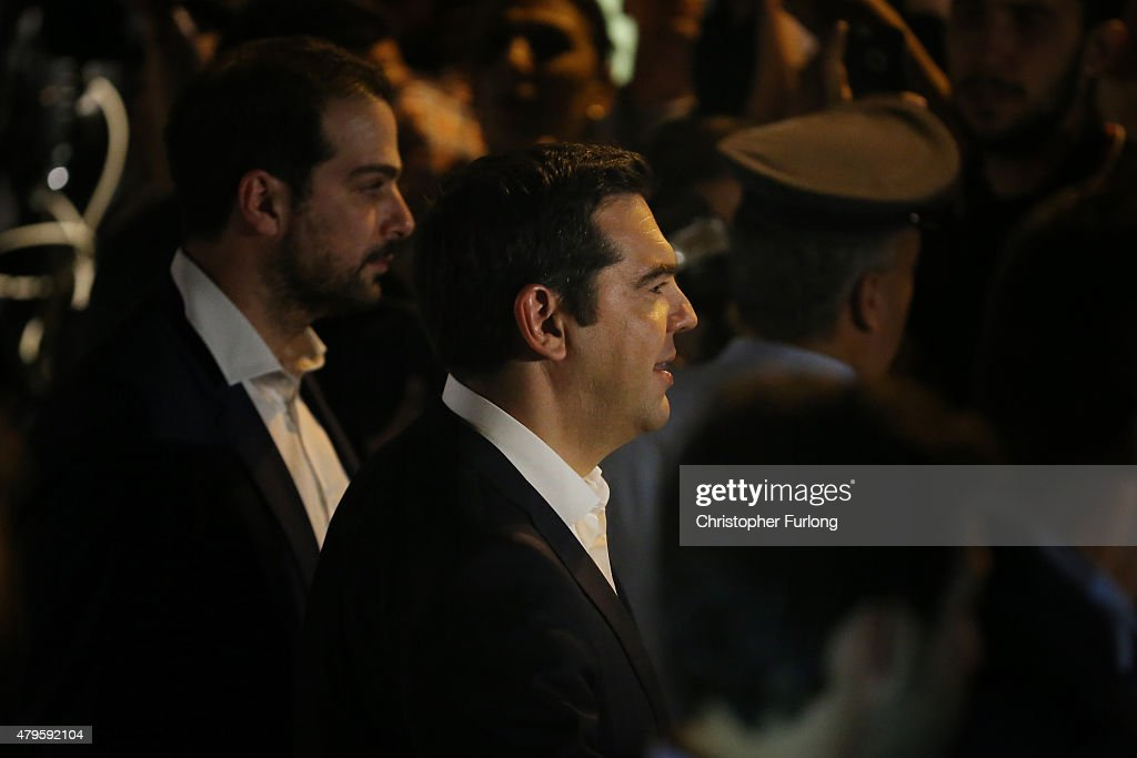 Greek Prime Minister Alexis Tsipras (C) leaves his residence to visit the President of Greece after the people of Greece rejected the debt bailout by creditors on July 6, 2015 in Athens, Greece. The greek people have rejected a debt bailout in a referendum with nearly 62% voting 'No', against 38% voting 'Yes' according to interior ministry figures