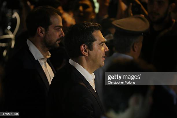 Greek Prime Minister Alexis Tsipras leaves his residence to visit the President of Greece after the people of Greece rejected the debt bailout by...