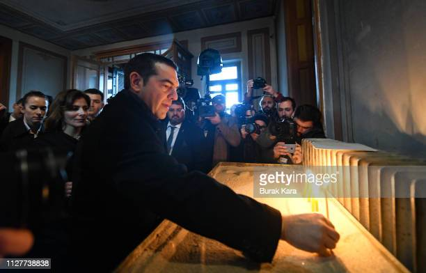 Greek Prime Minister Alexis Tsipras lights a candle as he visits the Theological School of Halki in Heybeliada Island on February 06 2019 in Istanbul...