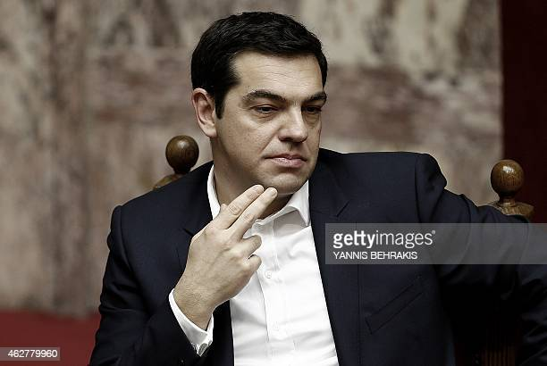 Greek Prime Minister Alexis Tsipras looks on during a swearingin ceremony of the new deputies that were elected in the January 25 national polls in...