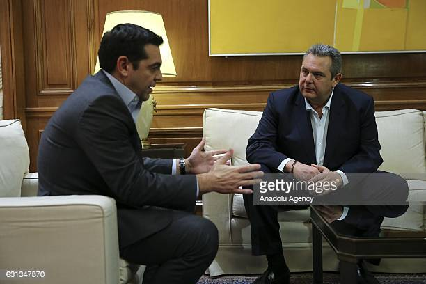 Greek Prime Minister Alexis Tsipras meets the Independent Greeks leader Panos Kammenos prior to attending a conference on Cyprus in Geneva on January...