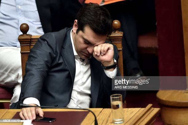 Greek Prime Minister Alexis Tsipras reacts during a parliament session in Athens on July 15 2015 AFP PHOTO / ARIS MESSINIS