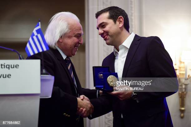 Greek Prime Minister Alexis Tsipras receives from International Politics magazine director Patrick Wajsman a prize rewarding political courage on...