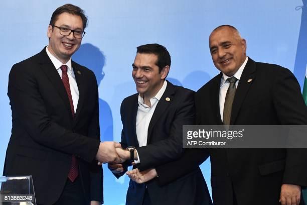 Greek Prime Minister Alexis Tsipras Serbian President Aleksandar Vucic and Bulgarian Prime Minister Boyko Borisov shake hands during a tripartite...