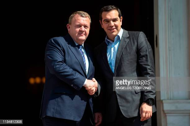 Greek Prime Minister Alexis Tsipras shakes hands as he welcomes his Danish counterpart Lars Lokke Rasmussen prior to a meeting at the Maximos Mansion...