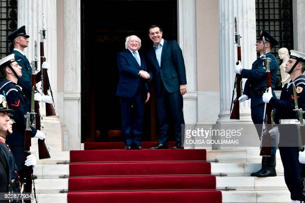 Greek Prime minister Alexis Tsipras shakes hands as he welcomes Irish president Michael Higgins prior to their meeting in Athens on February 22 2018...