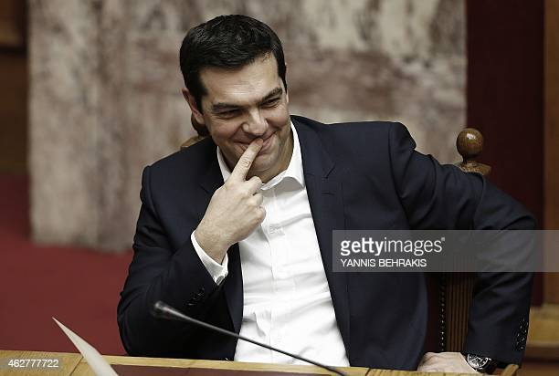 Greek Prime Minister Alexis Tsipras smiles as he attends a swearingin ceremony of the new deputies that were elected in the January 25 national polls...