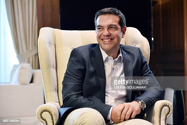 Greek Prime Minister Alexis Tsipras smiles during a meeting at his office in Athens on August 25 2015 Greece is likely headed for snap elections as...