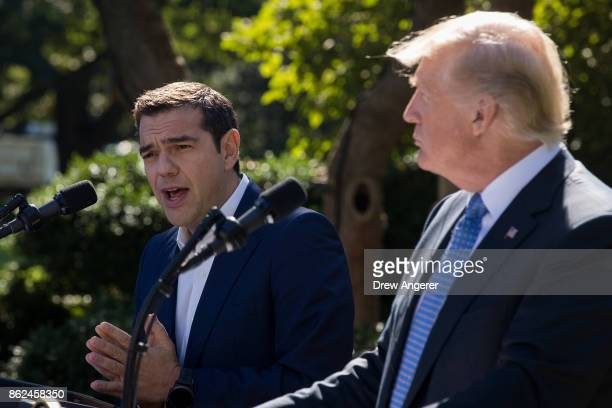 Greek Prime Minister Alexis Tsipras speaks as US President Donald Trump looks on during a joint press conference in the Rose Garden at the White...