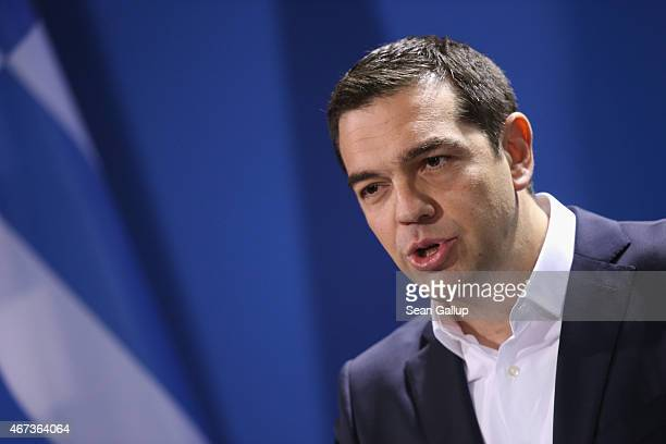 Greek Prime Minister Alexis Tsipras speaks to the media with German Chancellor Angela Merkel following talks at the Chancellery on March 23 2015 in...