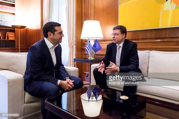 Greek Prime Minister Alexis Tsipras speaks with European Commission Vice President Valdis Dombrovskis during a meeting in Maximos Mansion in Athens...