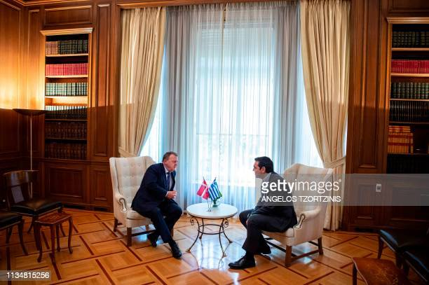 Greek Prime Minister Alexis Tsipras speaks with his Danish counterpart Lars Lokke Rasmussen during a meeting at the Maximos Mansion in Athens on...