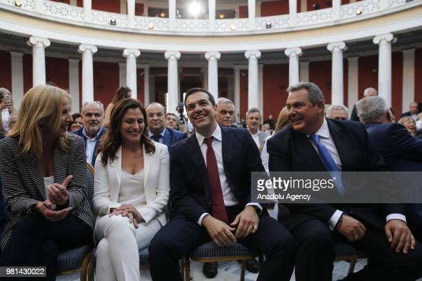 Greek Prime Minister Alexis Tsipras wearing a tie is seen before delivering a speech to lawmakers at the parliamentary group of Syriza and...