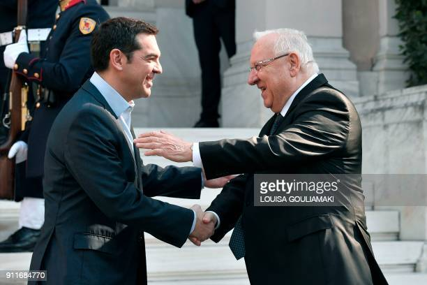 Greek Prime Minister Alexis Tsipras welcomes Israeli President Reuven Rivlin prior to their talks in Athens on January 29 2018 Rivlin arrived in...