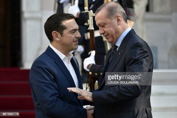 TOPSHOT Greek Prime minister Alexis Tsipras welcomes Turkish President Recep Tayyip Erdogan before their meeting in Athens on December 7 as part of...