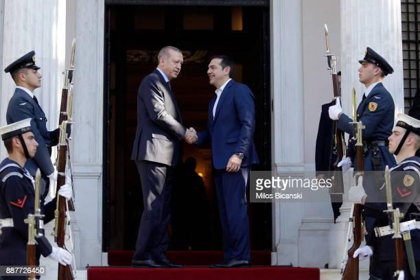 Greek Prime Minister Alexis Tsipras welcomes Turkish President Tayyip Erdogan at the Maximos Mansion in Athens Greece on December 7 2017Erdogan...