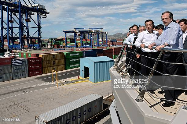 Greek Prime minister Antonis Samaras and Chinese Prime Minister Li Keqiang look on during the inauguration of a train line for containers at the port...
