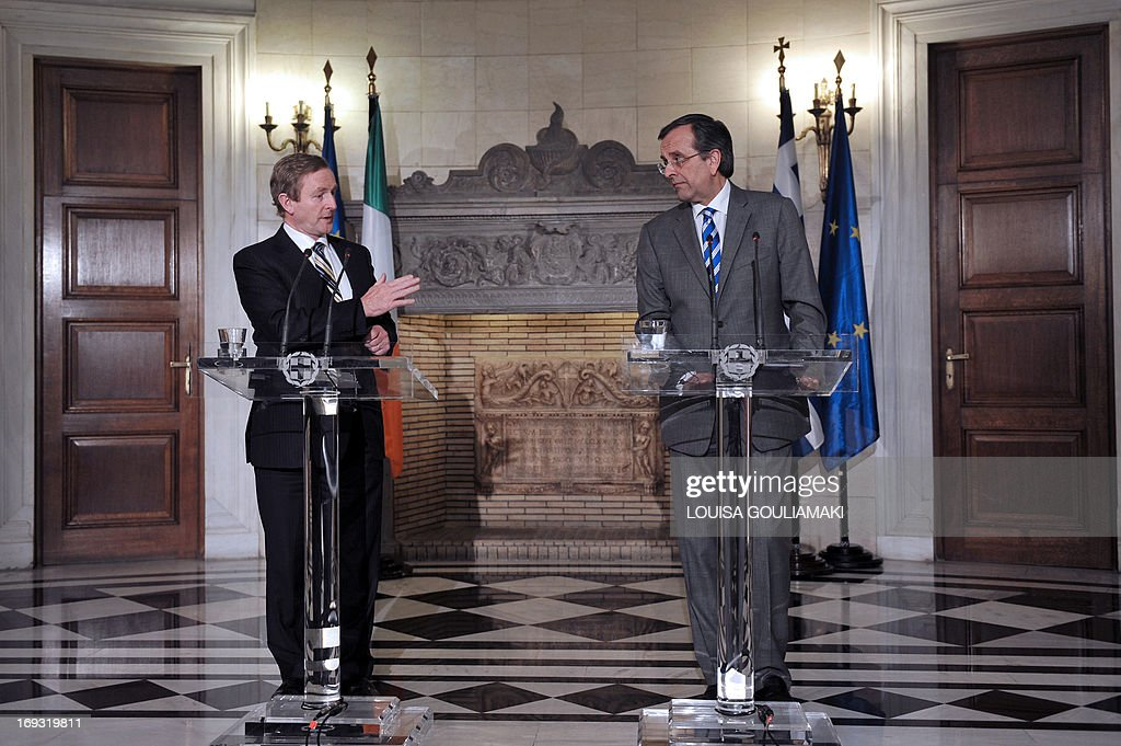 Greek Prime Minister Antonis Samaras (R) and his Irish counterpart, Enda Kenny, whose country has received an international bailout, speak to the media during a press conference in Athens as part of a working visit on May 23, 2013.
