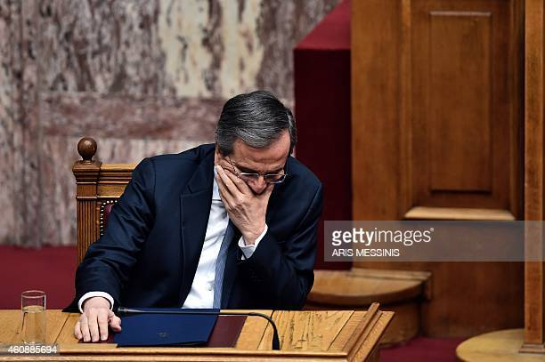 Greek Prime Minister Antonis Samaras attends the third round of a threestage presidential election in the Greek parliament in Athens on December 29...