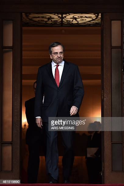 Greek Prime Minister Antonis Samaras exits his office before his meeting with his Spanish counterpart in Athens on January 14 2015 AFP PHOTO / ARIS...