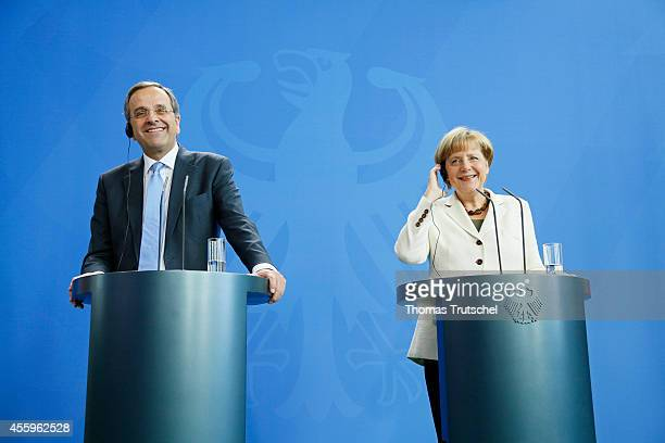 Greek Prime Minister Antonis Samaras speaks to the media with German Chanellor Angela Merkel following talks at Chancellery on September 23 2014 in...