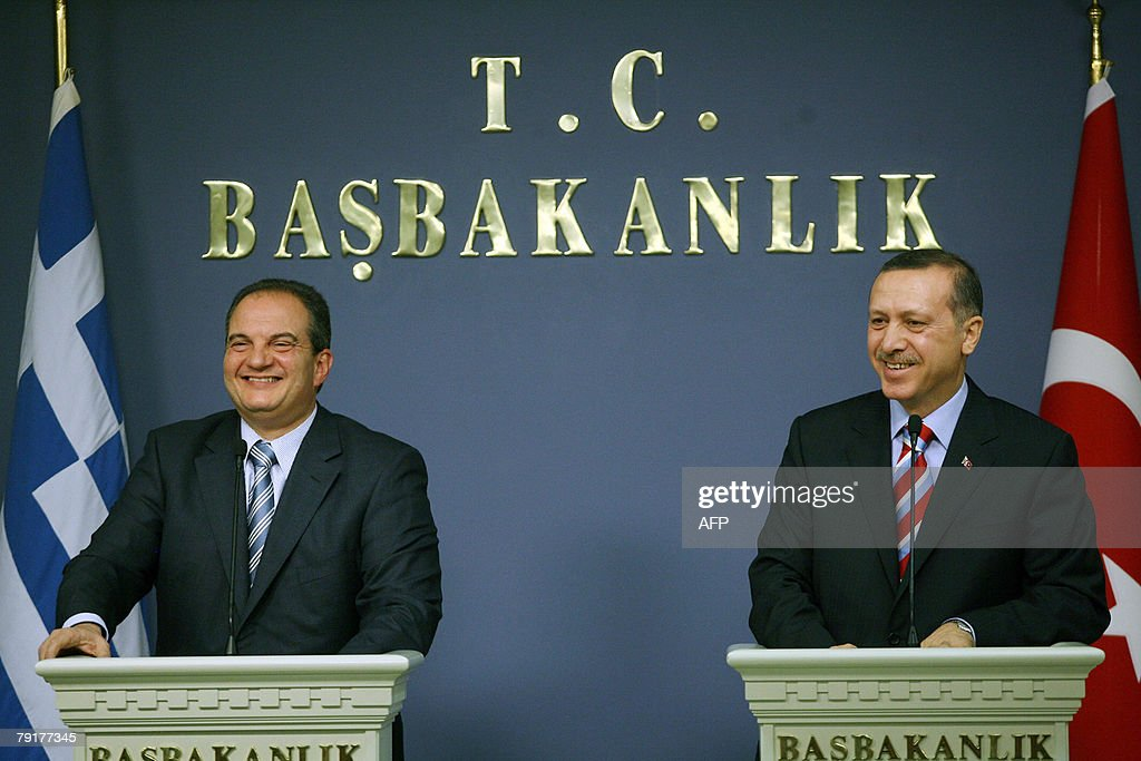 Greek Prime Minister Costas Karamanlis (L) and his Turkish counterpart Recep Tayyip Erdogan (R) give a press conferance after their meeting at the Erdogan's office in Ankara, Turkey, 23 January 2008. Greek Prime Minister Costas Karamanlis arrived here Wednesday for a landmark visit, the first to Turkey by a Greek premier in five decades, aiming to boost efforts to bring the two former enemies closer.