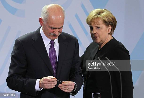 Greek Prime Minister George Papandreou and German Chancellor Angela Merkel depart after speaking to the media after talks at the Chancellery on...