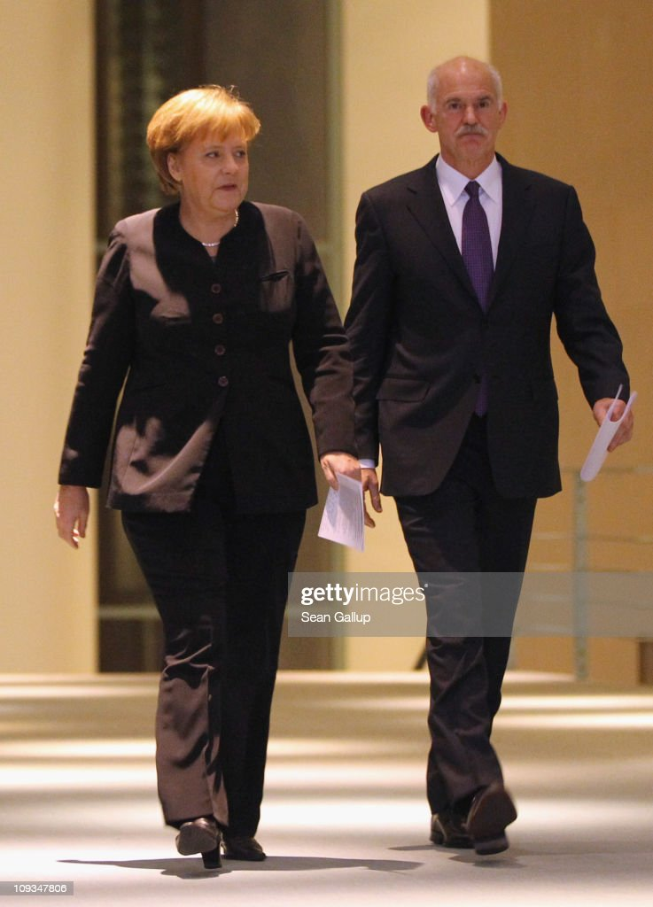 Greek Prime Minister George Papandreou and German Chancellor Angela Merkel arrive to speak to the media after talks at the Chancellery on February 22, 2001 in Berlin, Germany. Papandreou is seeking Merkel's support for the repayment period of Greece's 110 billion Euro crisis loan beyond 2016 and a reduction of the 5% interest rate, as well as to discuss details on a proposed set of measures to help Eurozone members in the future who run into financial hardship.