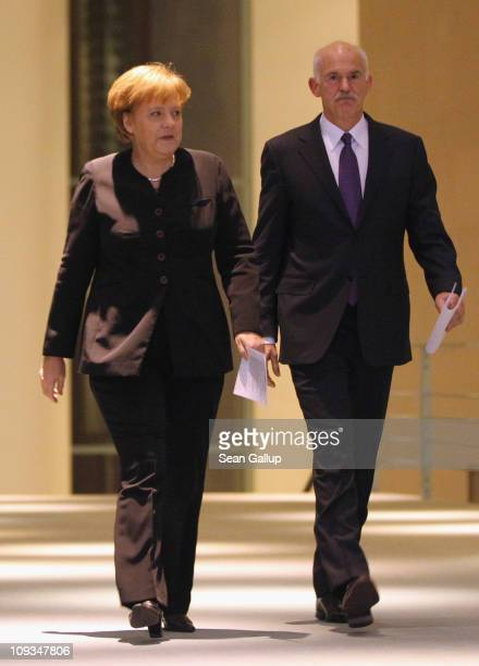 Greek Prime Minister George Papandreou and German Chancellor Angela Merkel arrive to speak to the media after talks at the Chancellery on February 22...