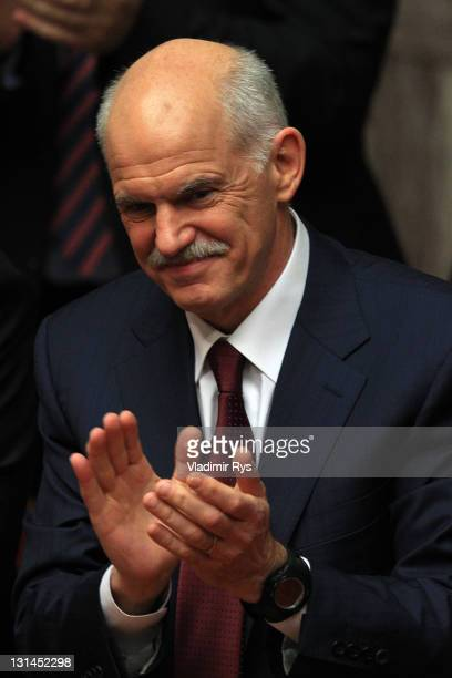 Greek Prime Minister George Papandreou applauds after winning the confidence vote for his government in the Greek parliament on November 04 2011 in...