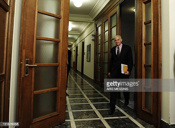 Greek Prime Minister George Papandreou arrives for a cabinet meeting at the Greek Parliament, on November 6 in Athens. Greek Prime Minister George...