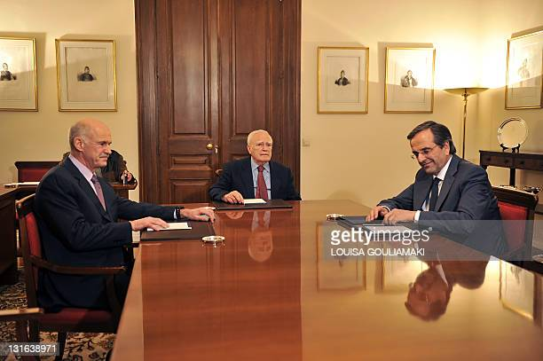 Greek Prime Minister George Papandreou , Greek President Carolos Papoulias and the leader of the main opposition party Antonis Samaras meet at the...
