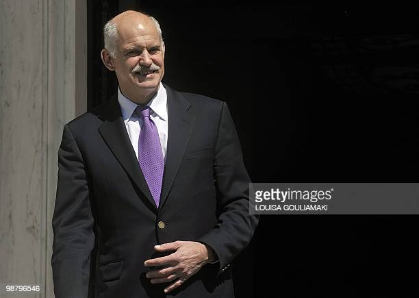 Greek prime minister George Papandreou stands outside his office in Athens on April 29, 2010. The EU and IMF have told the Greek government to slash...