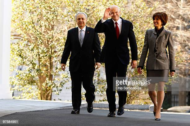 Greek Prime Minister George Papandreou waves to members of the news media while arriving at the White House March 9 2010 in Washington DC Papandreou...