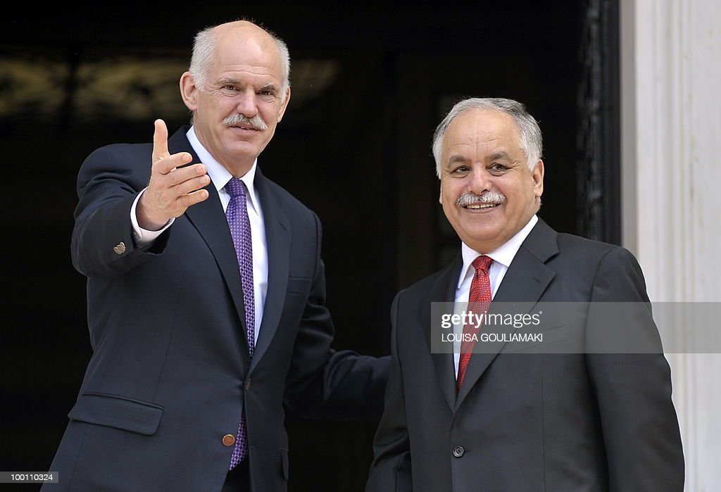 Greek prime minister George Papandreou (L) welcomes his Libyan counterpart, Al-Baghdadi Ali al-Mahmudi prior to their talks in Athens on May 21, 2010. AFP PHOTO / Louisa Gouliamaki