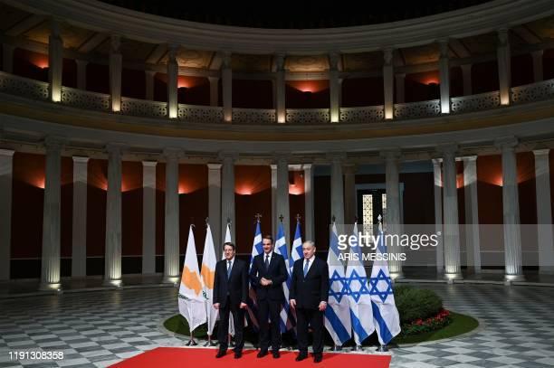Greek Prime Minister Kyriakos Mitsotakis his Israeli counterpart Benjamin Netanyahu and Cypriot President Nikos Anastasiadis pose in Athens on...