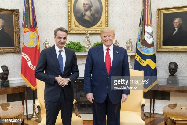 Greek Prime Minister Kyriakos Mitsotakis meets U.S. President Donald Trump in the Oval Office of the White House in Washington, United States on...