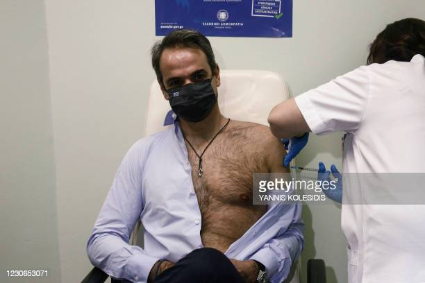 Greek Prime Minister Kyriakos Mitsotakis receives the second dose of a vaccine against the Covid-19 at the Attikon hospital, in Athens on January 18,...