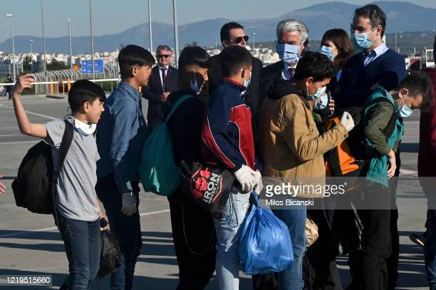 Greek Prime Minister Kyriakos Mitsotakis wearing a protective face mask arrives to attend the departure of unaccompanied migrant children from the...