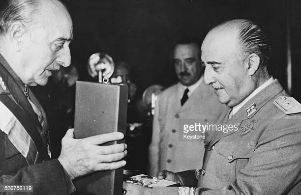 Greek Prime Minister Marshal Papagos and Spanish Prime Minister General Franco exchanging decorations during a ceremony at the El Pardo Palace Madrid...