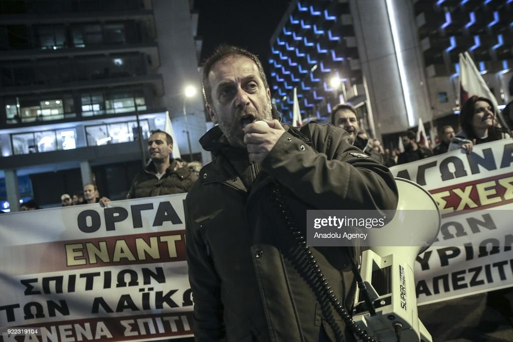 Greek protesters stage a demonstration against public auctions, organized by All-Workers Militant Front, in front of the Greek Department of Finance building in Athens, Greece on February 21, 2018.