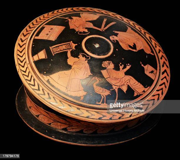 Greek 'pyxis' or trinketbox adorned with red figures Showing a woman holding a 'sprang' frame Made in Athens around 470 BC