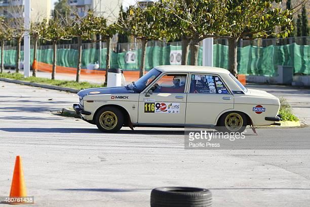 COMPLEX ATHENS ATTICA GREECE Greek rally driver Dimitrios Razis and his codriver Panagiotis Moraitis race in a Datsun 510 in the Golden Rally Show...