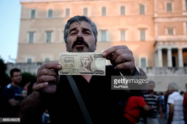 Greek Referendum Supporter of No in Syntagma square showing an old note of 1000 drachmas the greek currency before Euro era on Jun 29 2015