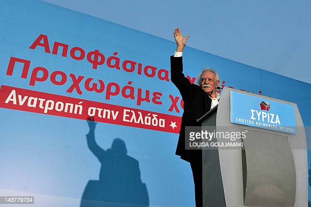 Greek resistance hero politician and writer Manolis Glezos greets the crowd at the start of the preelection rally of the Left Coalition Party in...