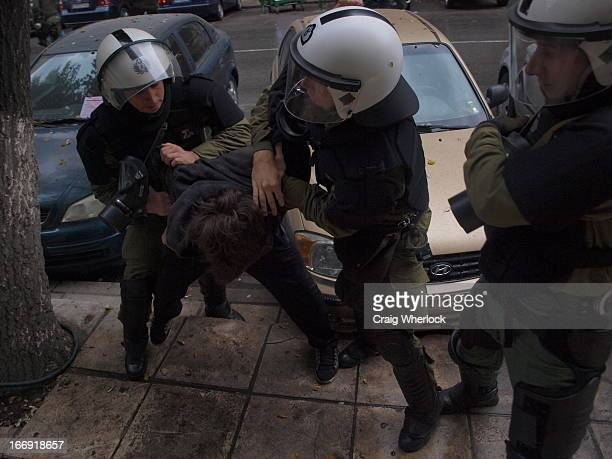 Greek riot police arrest teenager. Third anniversary of the death of Greek teenager, A. Grigoropoulos, killed by police in Athens.