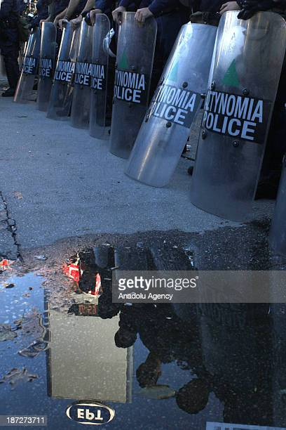 Greek riot police block the former Greek public broadcaster ERT headquarters on November 7 2013 in Athens Greece The riot police entered into the ERT...