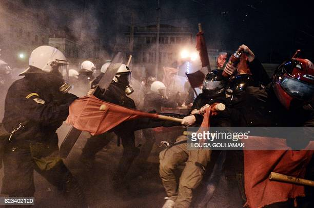 TOPSHOT Greek riot police clash with demonstrators protesting against the visit of the US president in Athens on November 15 2016 US President Barack...
