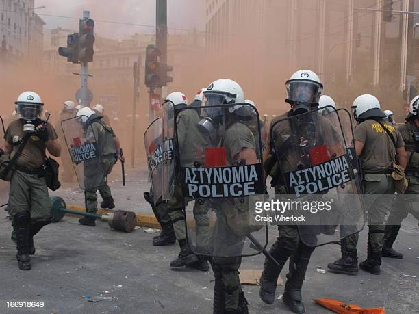 Greek riot police fighting protesters in central Athens.
